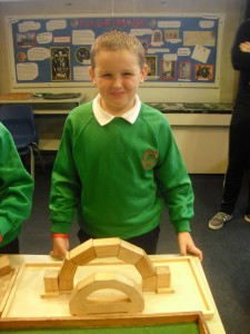 Ryan put the blocks together to create a free standing arch.